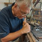 Tony White of TR White gunmakers, filing a wooden fore-end in his workshop