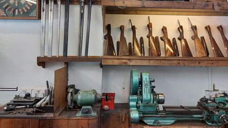 Blank gun stocks and other paraphernalia on a work top in TR White gunmakers