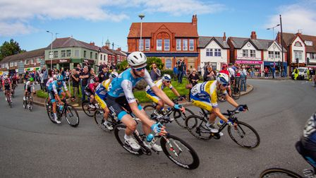 Riders races round a roundabout vying for the lead