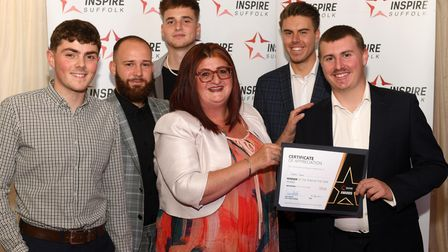 Some Inspire Suffolk Staff pictured holding their certificate