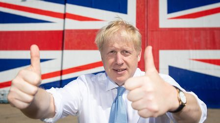 Boris Johnson poses for a photo at the Wight Shipyard Company at Venture Quay during a visit to the