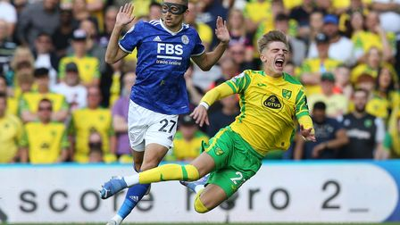 Brandon Williams of Norwich is fouled by Timoty Castagne of Leicester City during the Premier League