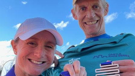 Kim and Ali Hutt after completing a 50 mile race taking in the Seven Sisters at Eastbourne - their furthest training run!
