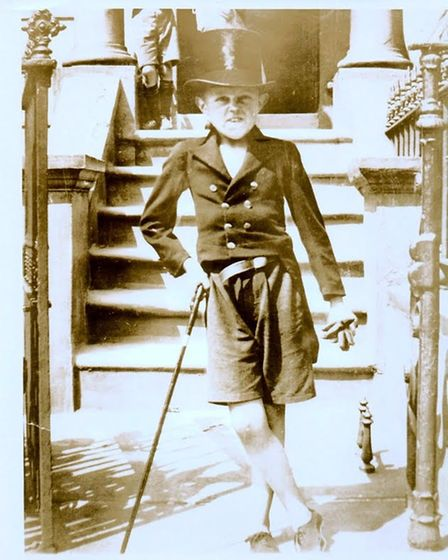 Ronnie Ronalde aged seven in 1930 on the steps of the Downham Road house