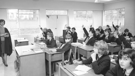 Hands raised to answer one of the teachers at Wymondham College in 1965.