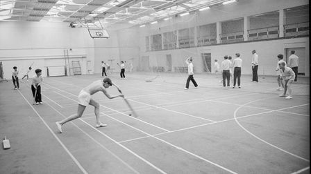 PE lesson where students learn to play cricket in Wymondham College sports hall in 1965.