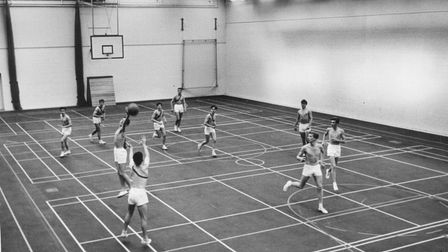 Wymondham College students enjoying a ball game in the sports hall in 1963