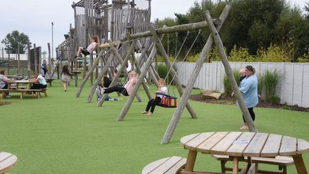 Families enjoy the new play area