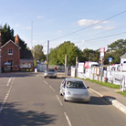 A Google Earth screenshot of a junction, and slightly beyond, a level crossing in Elsenham, Essex