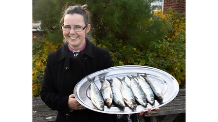 Vicar of Pakefield, Reverend Sharon Lord, with the tray of herring.