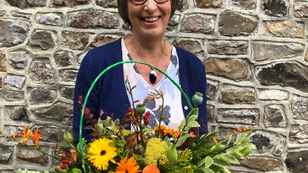 Julia Yates with a basket of beautiful blooms