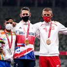 Great Britain's Jonathan Broom-Edwards celebrates with his gold medal after winning the Men's High J