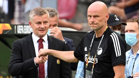 Manchester United manager Ole Gunnar Solskjaer and Stale Solbakken (right) fist bump on the touchlin