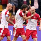 Stevenage's Ben Coker celebrates thefirst goal with Jake Taylor (right) against Swindon Town