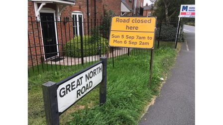 Road closure sign on the Great North Road near the Red Lion pub in Hatfield.