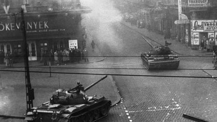 Soviet tanks cross a Budapest street as they move in to crush the anti-communist revolt. (Photo by ©