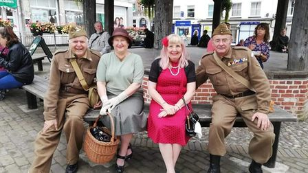 Underneath the town clock at the North Walsham VE Day commemoration were, from left, Derek Allen,