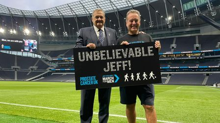 Gary Mabbutt congratulates Jeff Stelling at the end of his walking challenge at Tottenham Hotspur Stadium