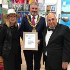 Marilyn Comparetto,CllrPeter Hebden, and Ignazio Comparetto with thethe Travellers' Choice Award forArt @ MG