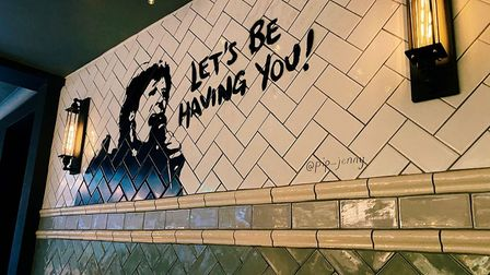The Delia Smith mural by the bar at The Ten Bells.