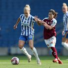Brighton and Hove Albion's Emily Simpkins (left) and West Ham United's Yui Hasegawa battle for the b