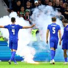 File photo dated 2-09-2021 of England's Declan Rice gestures towards the fans as a flare is thrown o