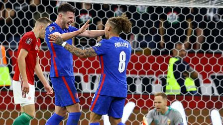 England's Declan Rice (left) celebrates scoring their side's fourth goal of the game during the 2022