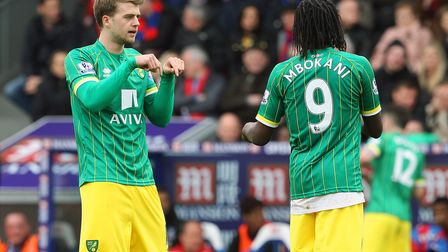 Patrick Bamford of Norwich and Dieumerci Mbokani of Norwich discuss tactics during the Barclays Prem