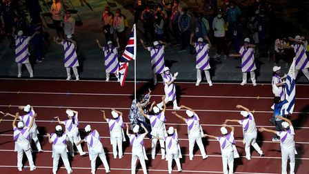 Flagbearer Great Britain's David Smith (centre) during the closing ceremony of the Tokyo 2020 Paraly