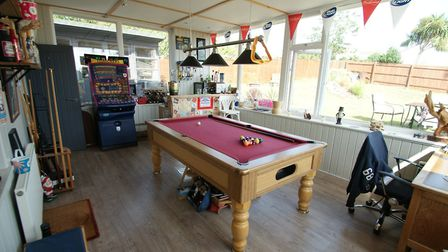 A specialist games room - or alternative separate dining room - is situated to the rear of the prope