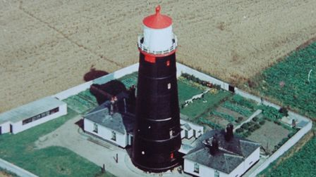 Happisburgh Lighthouse was painted in black bitumen 50 years ago. It was intended to be a sealant