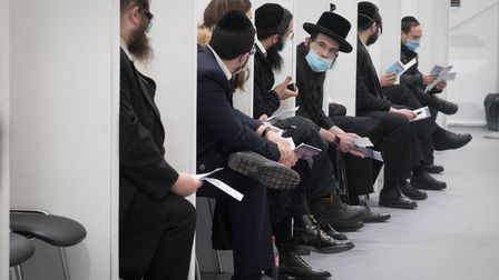 Members of the Jewish community in north London wait to receive their Covid-19 vaccination at the Jo