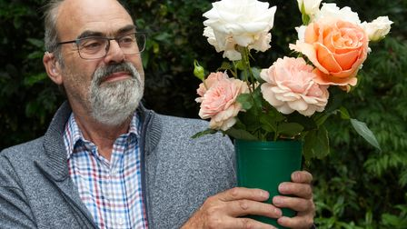 Prof Steve Marston with his prize winning Roses at Highgate Horticultural Society Autumn show 2021
