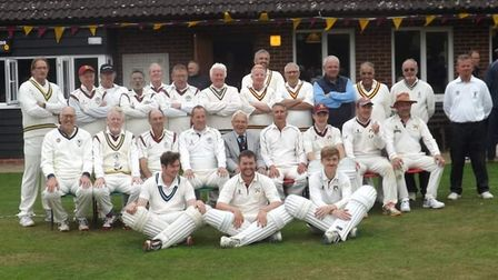 The two teams gather at the end of the Philip Gillet memorial match at Waresley Cricket Club.