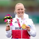 Great Britain's Laura Sugar celebrates with her gold medal after winning the Women's Kayak Single 20