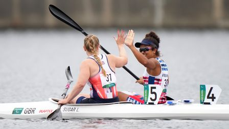 Two women - Laura Sugar and Neila Barbosa - on boats after the Paralympic Canoe Slalom final