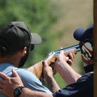 A member of Queens Park Rangers receiving clay shooing tuition on a team building day at West London Shooting School