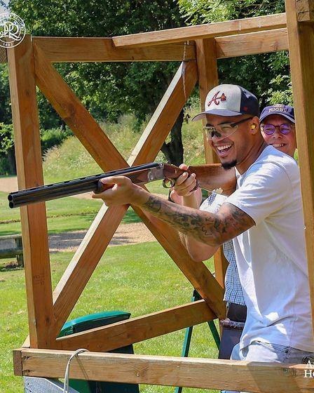 A member of Queens Park Rangers football team clay shooting at West London Shooting School