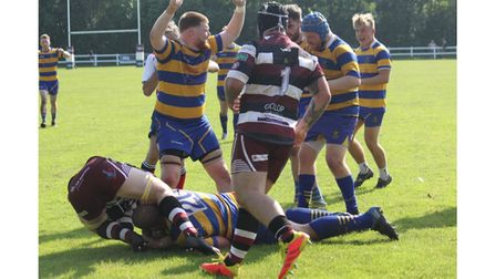 Clevedon RFC's Oli Jones powers over to score at Cleve.
