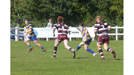 Clevedon's Thomas passes to Carpenter during their game with Cleve.