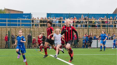 Youngsters run on to the new 3G pitch for Uttlesford in Saffron Walden