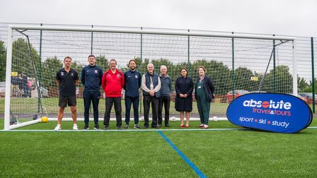 Group shot of supportive individuals behind the new 3G pitch at Saffron Walden