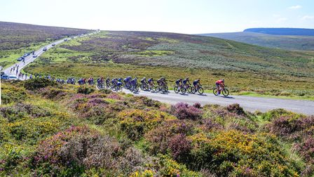 The peloton makes their way into Moretonhampstead during the Tour of Britain 2021 Stage Two crossing