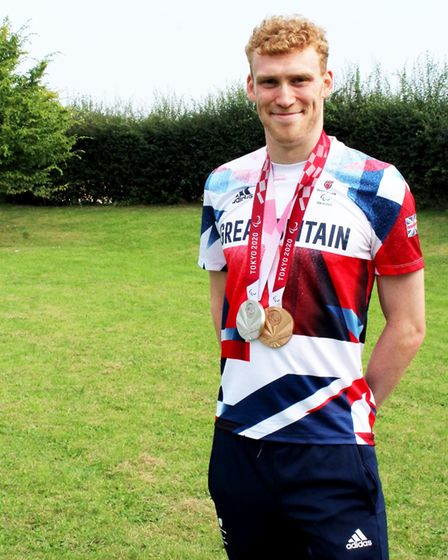 Double Paralympic medallist George Peasgood wearing his Tokyo 2020 medals in Saffron Walden