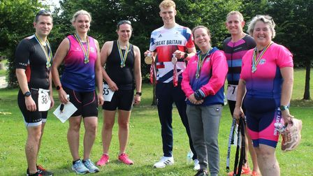 A group of seven people in sports gear in Saffron Walden, including George Peasgood