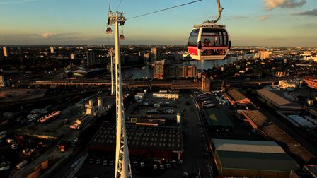 The Emirates Air Line cable car was scaled by Greenpeace activists (Picture: PA Images)