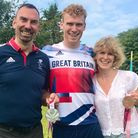Double Paralympic medallist George Peasgood and his parents David and Teresa pose for a photo