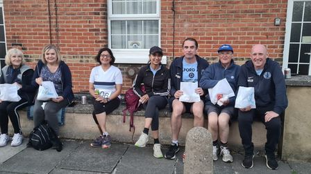Ilford AC runners and volunteers enjoying fish and chips