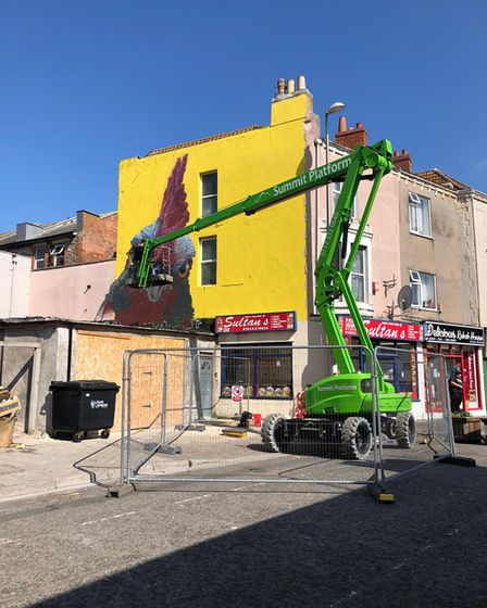 Rooster being painted for Weston Walls.