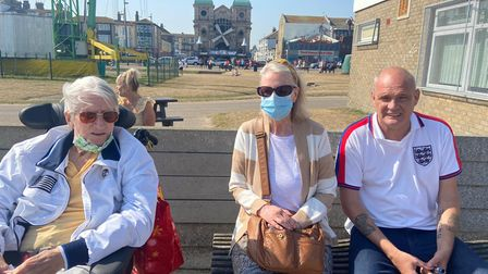 David, April and Phil sitting on a bench on Great Yarmouth seafront.